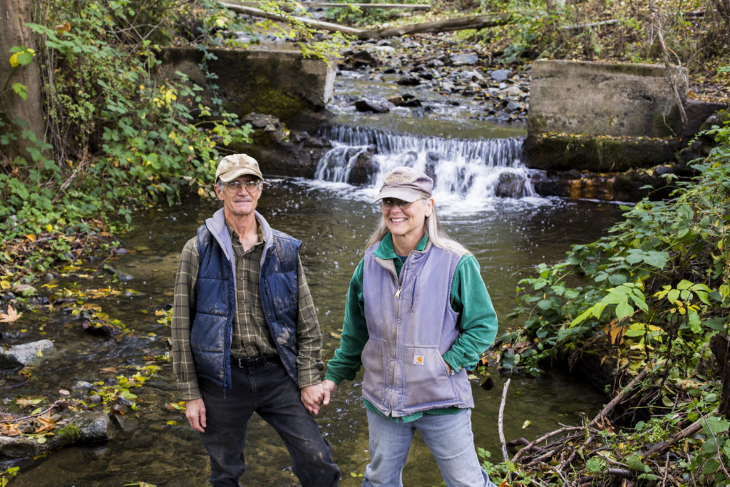 Alain and Jody Herriott are among 19 property owners who use water that's diverted by the small dam and support the dam removal. (Credit: Justin Clifton)